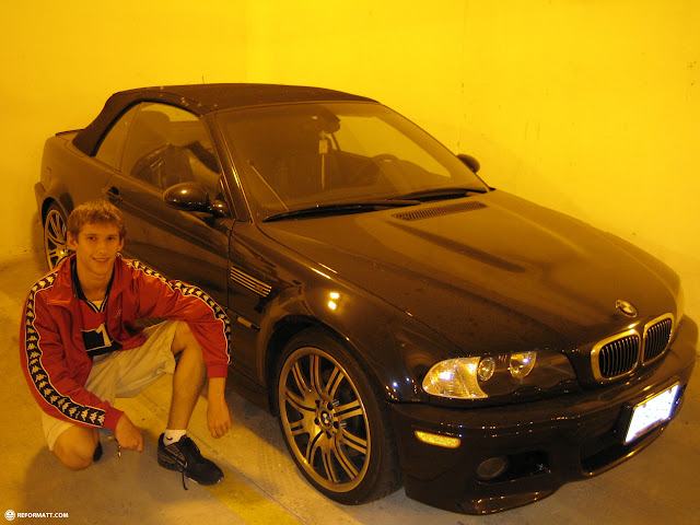 posing with hot cars in the garage in Mississauga, Ontario, Canada