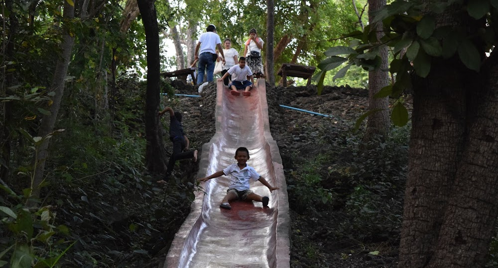there is a fun slide going down a good portion of the way, that these boys are having a blast on!