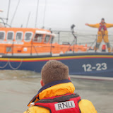 'Come on guys - you've got loads of space yet!' Poole lifeboat coming alongside Swanage lifeboat during a training exercise in Poole Bay on Sunday 23 February 2014. Photo: RNLI/Dave Riley