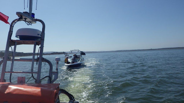 Poole ILB crew towing a wakeboarding vessel that was taking on water near Rockley in Poole Harbour on Saturday 20 April 2013. Photo: RNLI/Alex Evans