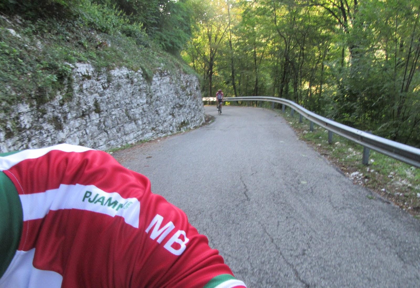 Cycling Monte Grappa - Cavaso del Tomba - roadway and cyclist