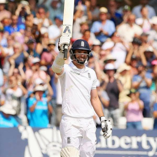 England's James Anderson celebrates reaching 50 runs during the fourth day of the first cricket Test match between England and India at Trent Bridge in Nottingham, central England, on July 12, 2014