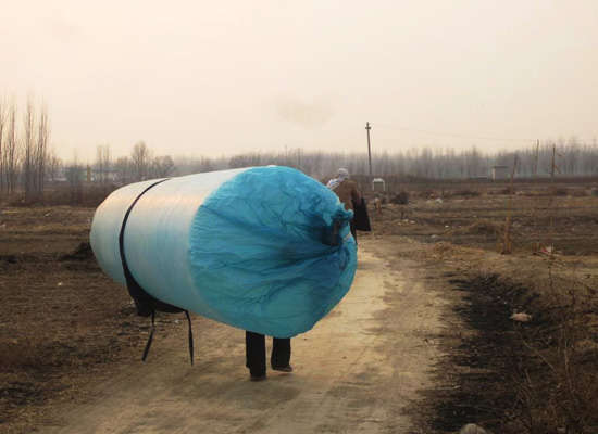 Villagers Inflate Plastic Bags with Natural Gas to Carry Home
