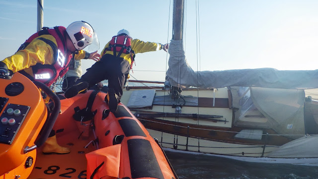 Poole ILB transferring a crew member to a yacht aground on Hook Sands in Poole Bay on 8 August 2013 Photo: RNLI/Poole