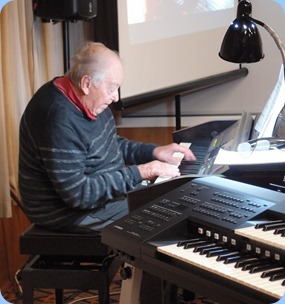 Merv Adair playing the Club's Clavinova CVP-509. Photo courtesy of Dennis Lyons.