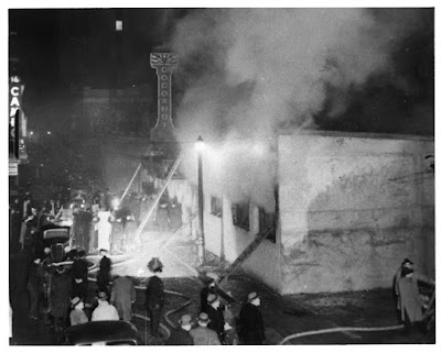 One of few pictures showing fire in progress.  Piedmont Street.  Courtesy of NFPA.  Copyright queries to NFPA.