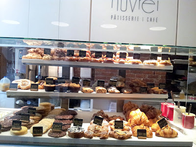 <br /> baked goods from Nuvrei, bagels, croissants, scones, muffins, macarons, macaroons, bagel sandwich, danishes, cookies, biscuit, brioche, sandwiches, Nuvrei Patisserie and Café