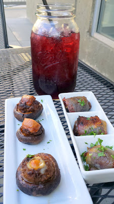 Pink Rose Restaurant happy hour option of the Chorizo Stuffed Mushrooms with Painted Hills beef house chorizo and Manchego cheese plus Bacon wrapped Dates wtih Medjool stuffed dates, toasted almonds, Rogue blue cheese to accompany a Patio Punch Mason Jar (quart size!) of sangria