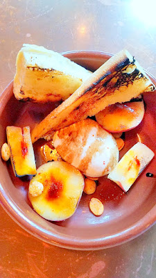 Burrata with glazed peaches, marconas, saba, olive oil, and griddled bread from LeChon