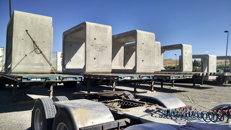 flatbed trailers loaded with cement box culverts