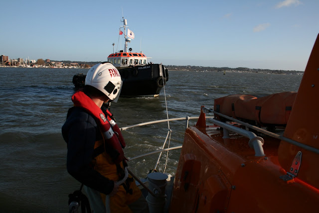 Poole lifeboat training with a commercial workboat