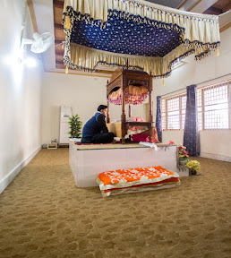 A young boy reciting Guru Granth Sahib quietly, and cannot speak anything while he is reciting it and when he finishes, someone else takes on his place. This way, Guru Granth Sahib is recited 24 hours nonstop.