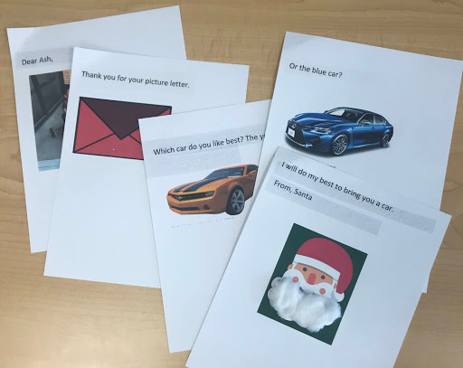 4 pages spread on a table each with a simple sentence and a picture as a reply from Santa. the santa picture has cotton balls on the beard.