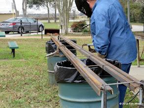 Photo: Pete Greene trying to weld engine barn rail together.   2014-0104 RPW