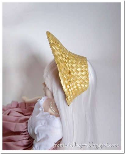 Trim the cut edges to fit on your doll.  It fits a little like a large headband with a brim.