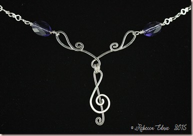 treble clef and flourish necklace