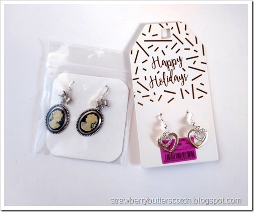 A package of cameo earrings and a packaged of heart earrings, both bought on clearance and ready to be turned into necklaces.
