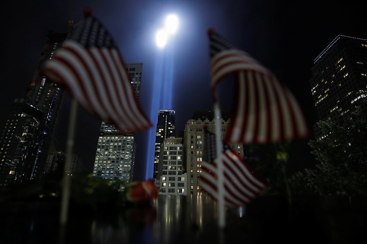 The Tribute in Light installation is illuminated over lower Manhattan marking the 17th anniversary of the 9/11 attacks.