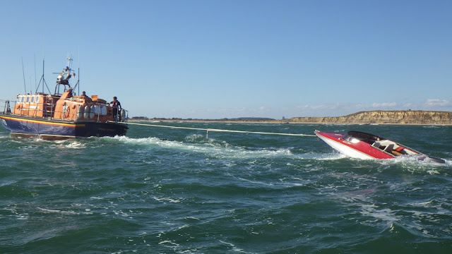 The ALB tows a speedboat that had capsized during the air show - 31 August 2014.  Photo credit: Poole RNLI