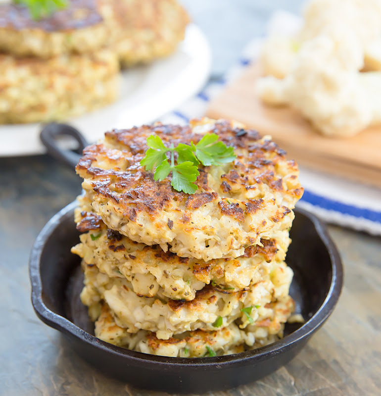 close-up photo of a stack of Cauliflower Fritters in a small skillet