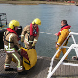 20 April 2012 - Firefighters unload more hoses onto Green Island. Photo: RNLI/Poole Lifeboat Station Anne Millman