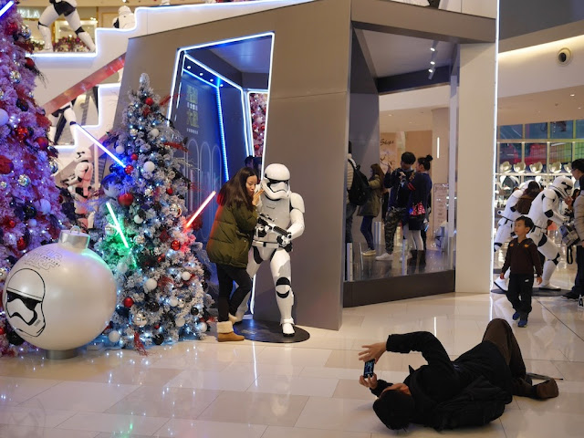 young woman posing with a Star Wars Stormtrooper at the IAPM shopping center in Shanghai