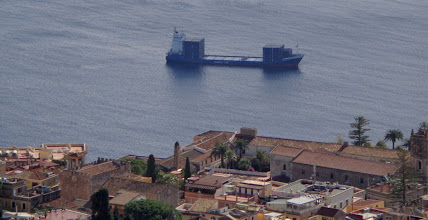 Photo: Passing container ship - and 500ft above it, the San Domenico Palace Hotel