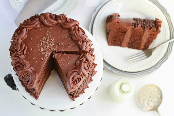 Ultimate Triple Chocolate Layer Cake - A triple layer chocolate cake with milk chocolate frosting covered with mini chocolate chips.jpg