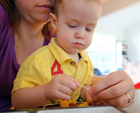 Mad with Moxie: Mother and son making noodle necklaces together.