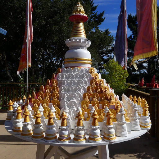 Table with many small Kadampa stupas to circumambulate Kachoe Dechen Ling,  Aptos, CA, USA.
