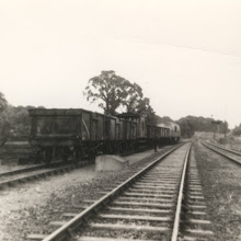 Photo: Trucks being delivered and to be shunted into the siding this end - the rest will return to Oxford (1969?)