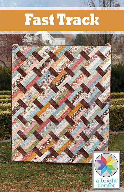Fast Track quilt pattern from A Bright Corner - uses jelly roll strips, layer cake squares, fat quarters, or yardage and pattern has four sizes