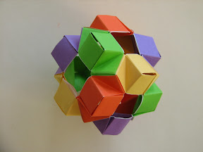 Cube from Oxi-Modules by Michal Kosmulski: http://hektor.umcs.lublin.pl/~mikosmul/origami/oxi/index.html