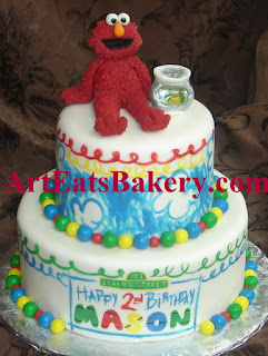 Two tier Elmo's World Seseame Street hand painted birthday cake with fondant Elmo and fish bowl topper idea