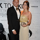 WWW.ENTSIMAGES.COM -     Lee Trundle and Jane Copeland  arriving    at      THE UK PREMIERE OF (JACK TO A KING) THE SWANSEA STORY at EMPIRE, LEICESTER SQUARE London September 12th 2014.The movie of Swansea City's rise from near extinction to the top of the Premier League                                                 Photo Mobis Photos/OIC 0203 174 1069