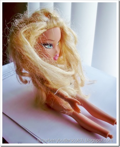 Poor little thrift shop Bratz doll before her makeover.