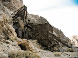 Looking at the headframe, orebin and blacksmiths shop situated on the side of the mountain. The hoist works sat lower on the mountain side.