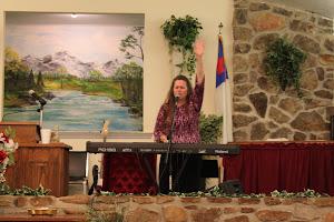 Loving Jesus as we sing.