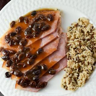 Maple-Glazed Ham with Cider Raisin Sauce.