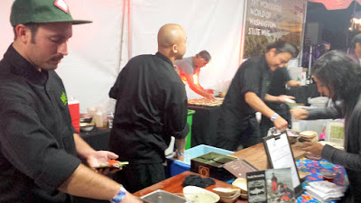 Longest line at Night Market goes to Jin Soo Yang of Bamboo Sushi offering a choice of: Illamna Sockeye from Bristol Bay handroll or Yasai Moriwase handroll