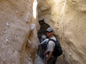 Mark and crew negotiate through the narrowing slot canyon.