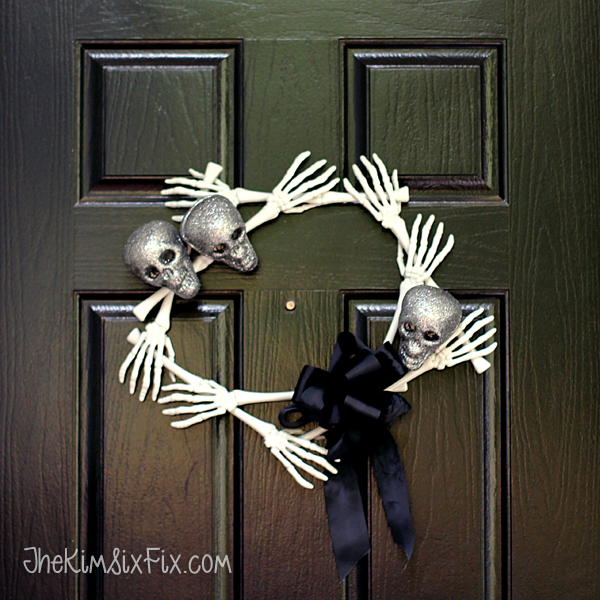 Skull and bones halloween wreath with black ribbon
