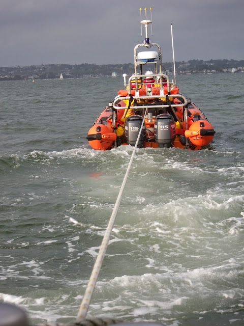 Poole ILB towing Dolphin III during a training exercise - 22 April 2014 Photo: RNLI Poole/Anne Millman