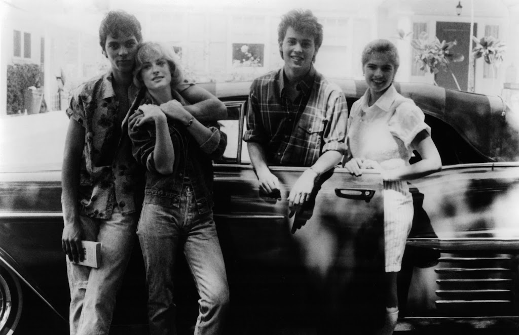 Nick Corri, Amanda Wyss, Johnny Depp, and Heather Langenkamp posing beside car in a scene from the film 'A Nightmare On Elm Street', 1984. (Photo by New Line Cinema/Getty Images)
