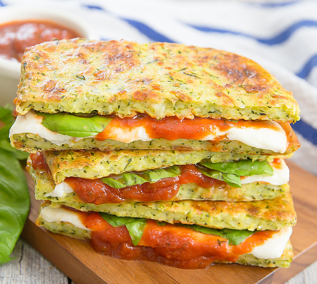 photo of a stack of Zucchini Crusted Pizza Grilled Cheese Sandwiches