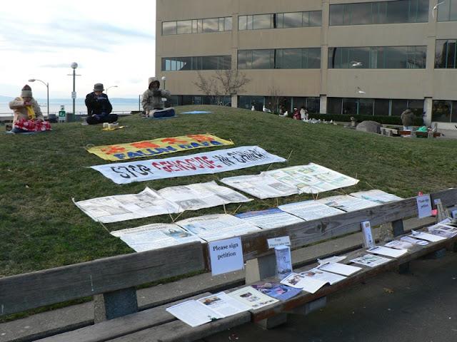 banners on hillside saying Falun Dafa Stop Genocide in China