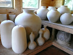 Dry pots waiting for the kiln.