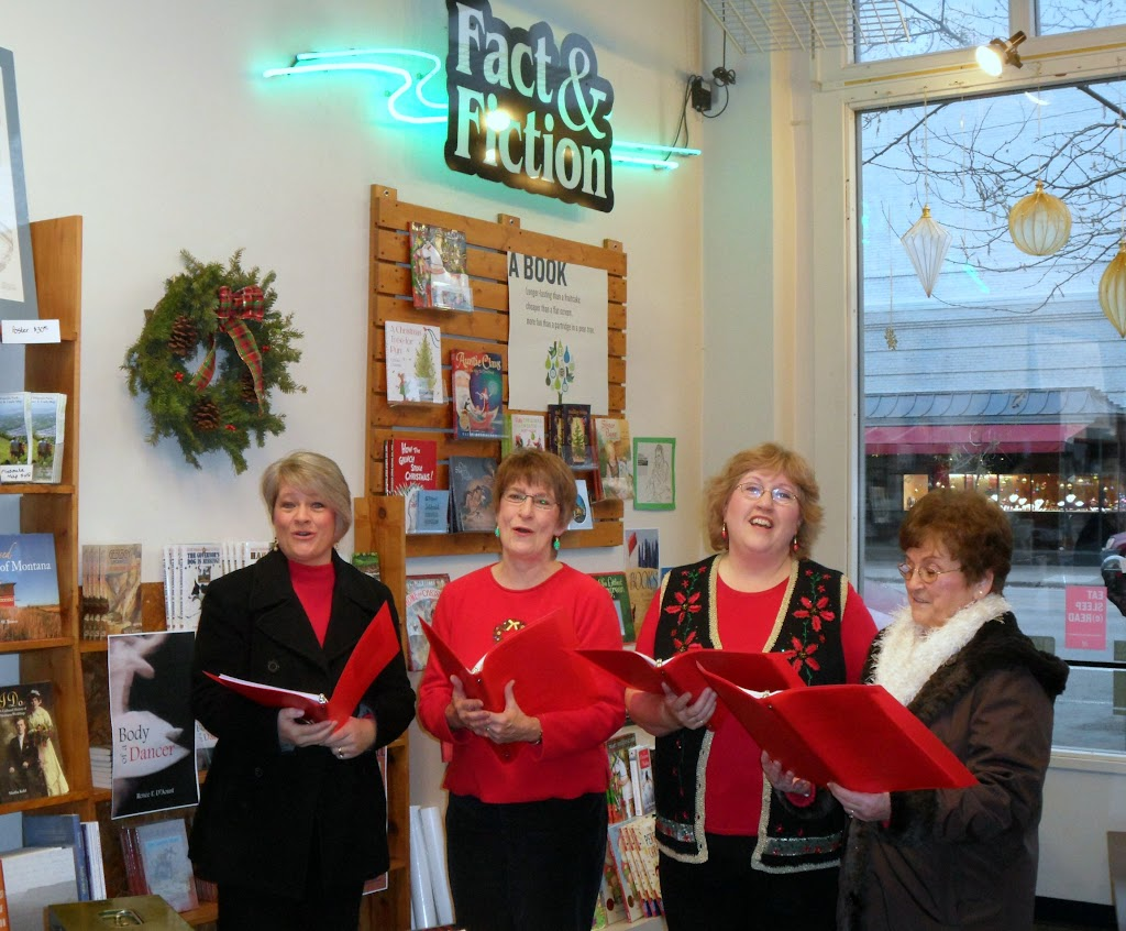 The Sweet Adelines carol for the crowd at Fact & Fiction.