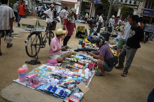 items for sale at an outdoor market in George Town, Penang, Malaysia