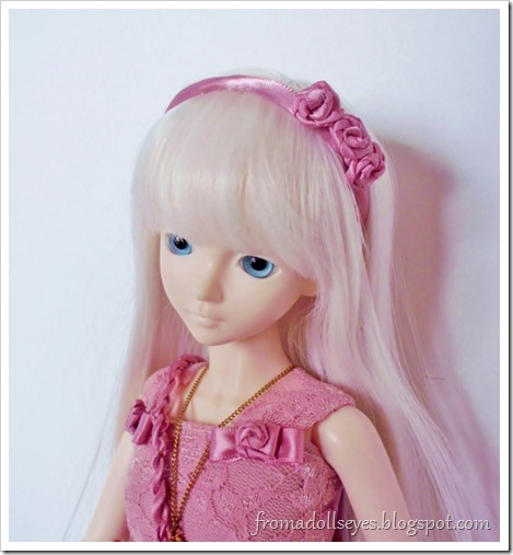 Matching pink rose head band for a doll.